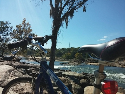 Bike resting on railing at the edge of the Chattahoochee River. Photo by Tracie Sanchez.