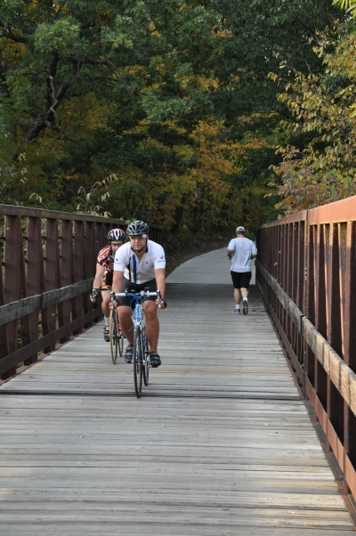 Bicyclists and joggers crossing a bridge on the Neal Smith Trail. Photo by Dayne Magneson.