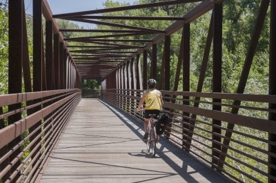 The Poudre Trail has many miles of paved trails and sturdy bridges to ride your bike on along the Cache la Poudre River. Photo by Gabriele Woolever.
