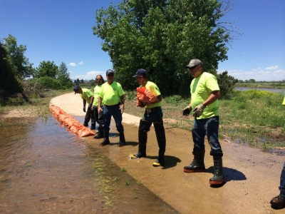 Volunteers work quickly to make the Poudre Trail accessible despite the seasonal spring flooding. Photo by Hailey Groo.