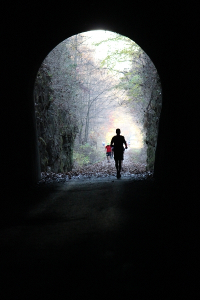 Runners through the tunnel. Photo by Jonathan Voelz.