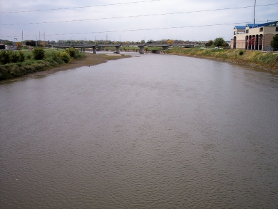 The Raccoon River inDes Moines, Iowa, as viewed upstream from a pedestrian bridge at its mouth at the Des Moines River. Photo by Tim Kiser.