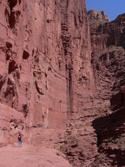 Red rocks wall with hiker for scale. Photo by Stuart Macdonald.