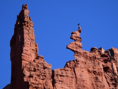 A climber savors the moment at Fisher Towers. Photo by Valerie A. Russo.