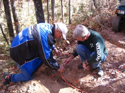 Cheaha Trail Riders installing traffic counters on one of the OHV trails in Minooka Park. Photo by Rob Grant.
