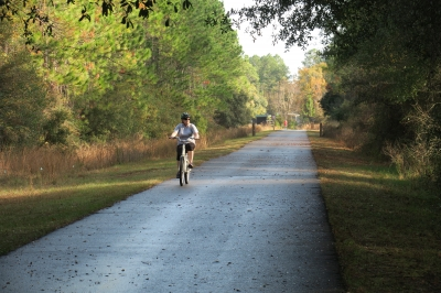 Rider on Blackwater Heritage State Trail. Photo by Doug Alderson.