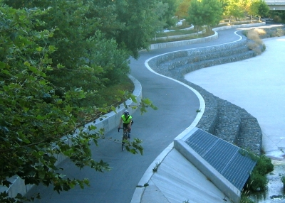 Bicycle commuter traveling in the morning along the Guadalupe River Trail. Photo by Yves Zsutty.