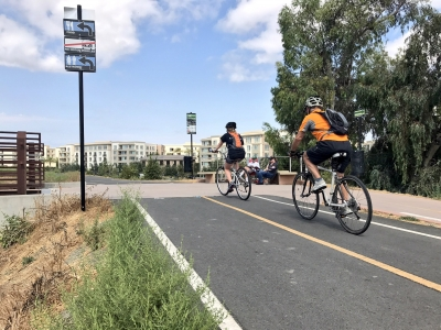 Bicyclists enjoying a sunny Wednesday through North San Jose. Photo by Yves Zsutty.