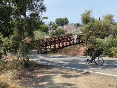Two bridges cross the creek. One by Trabuco rd and the other just north of Jeronimo rd.