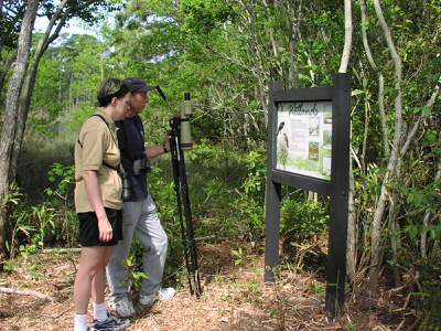 Vistors using one of our interpretive signage.