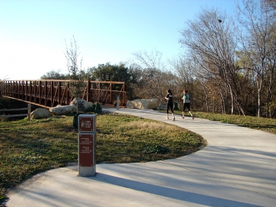 Joggers enjoying a beautiful day on the Leon Creek Greenway near the Via Transit Center Trailhead. Photo by Brandon Ross.