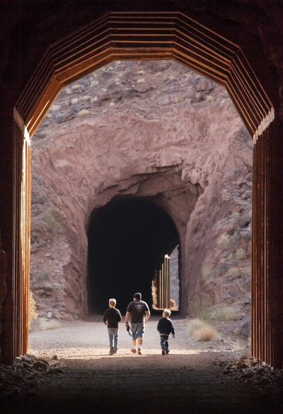 Visitors entering one of five tunnels at Historic Railroad Trail, Lake Mead NRA. Photo by Andrew Cattoir.