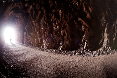Visitor exits in a glow of light at the Historic Railroad Trail, Lake Mead NRA. Photo by Andrew Cattoir.