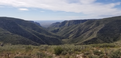 Slaughter Canyon spills out into the Chihuahuan desert. Photo by Todd Shelley.