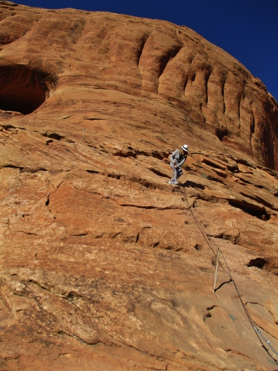 Hold onto the cable to climb or descend the steep section of slick rock. Photo by Valerie A. Russo.
