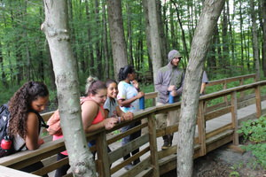 A group of high school students are visiting the trail as part of the Urban Refuge Partnership in Springfield, Mass