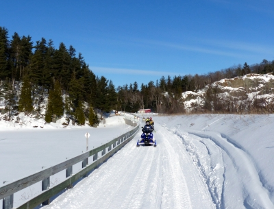 Snowmobiling along ledgeway at Pine Hill Quarry. Photo by Carol Fulsher.