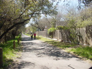 People walking on the Salado Creek Greenway North near Voelcker Trailhead