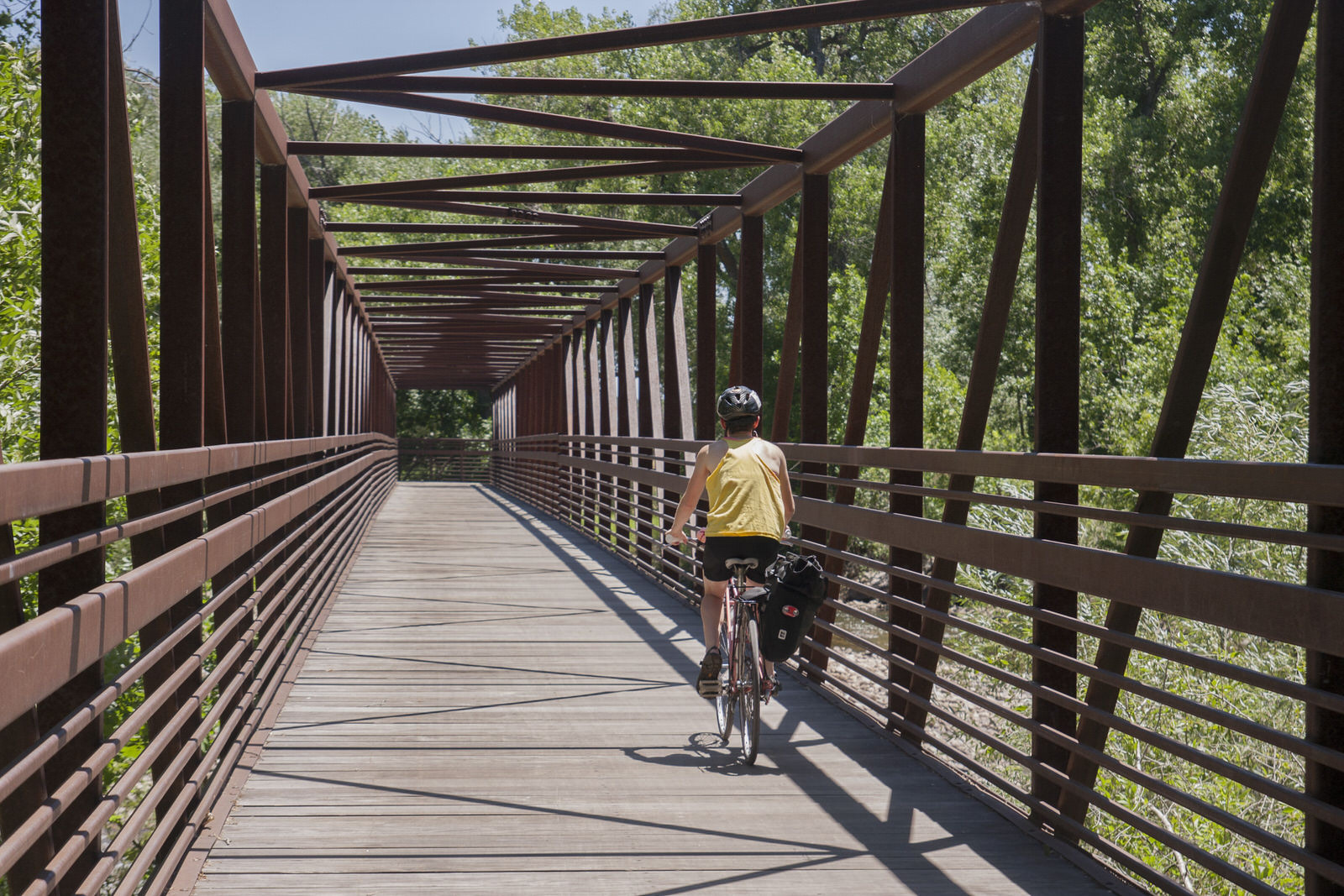 photo: The Poudre Trail has many miles of paved trails and sturdy bridges to ride your bike on along the Cache la Poudre River. Photo by Gabriele Woolever.