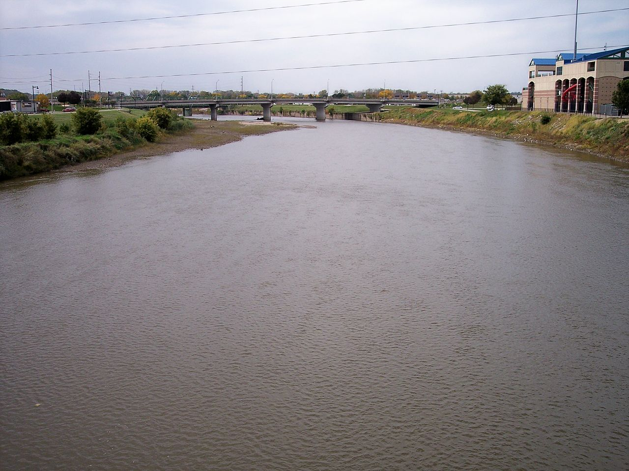 photo: The Raccoon River inDes Moines, Iowa, as viewed upstream from a pedestrian bridge at its mouth at the Des Moines River. Photo by Tim Kiser.