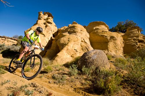 photo: Paul DeWitt, rider passes one of the many formations on the High Desert Trail System during the High Desert Screamer.