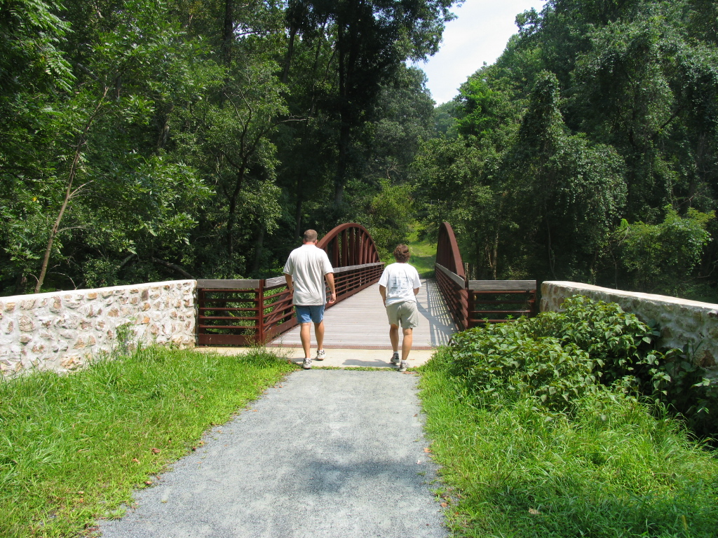 photo: Walking over a pedestrian bridge on the Pomeroy and Newark Rail Trail. Photo by Avery Dunn.