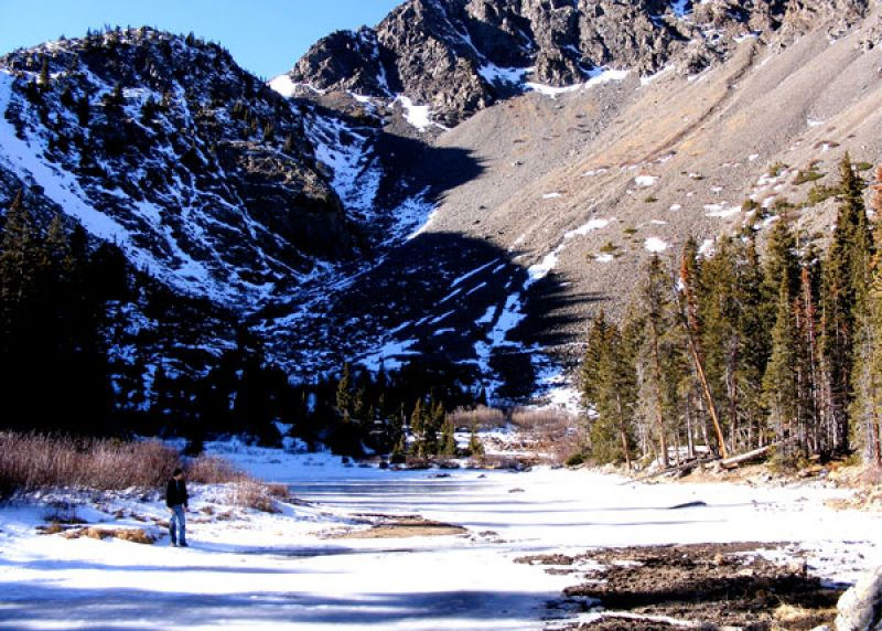 photo: On the banks of a run-off stream with Pacific Peak in the background.